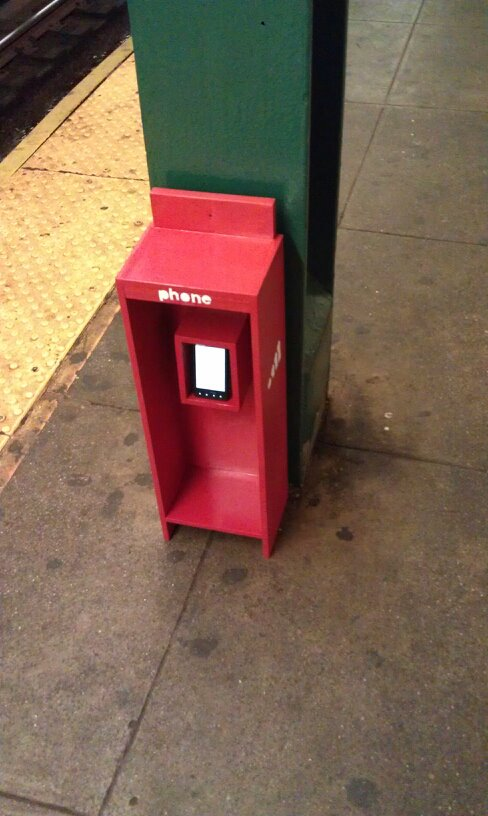 community phone booth in new york subway